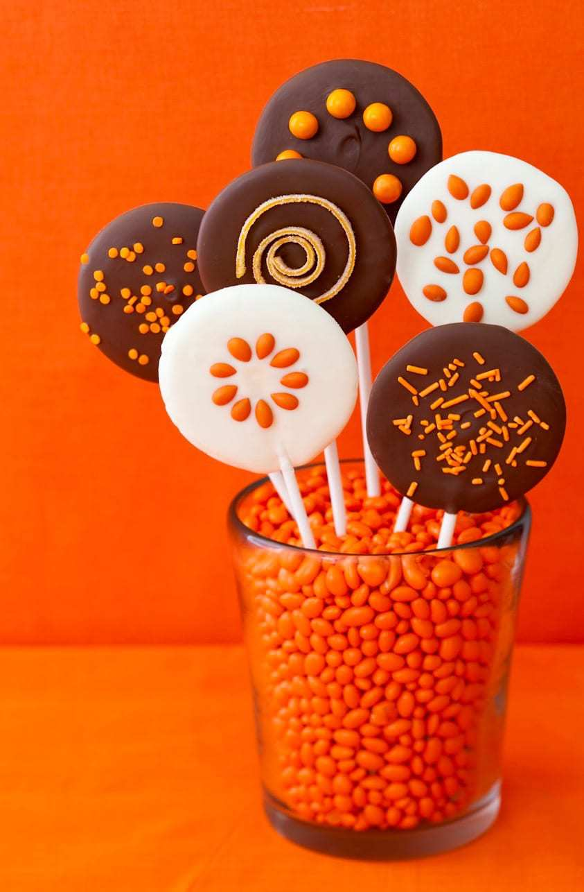 Easy Halloween Chocolate Lollipops in glass on orange background