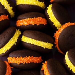 Close up of Halloween Whoopie Pies with orange yellow candy sprinkles