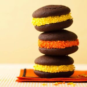 Three Halloween whoopie pies stacked on top of each other