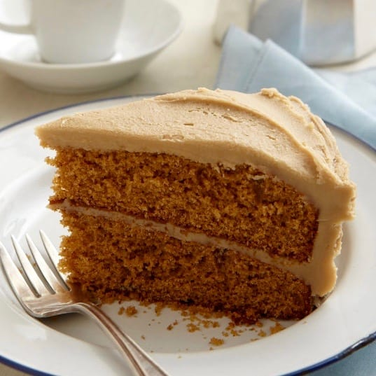 Creamy Caramel Icing on a slice of Classic Spice Cake
