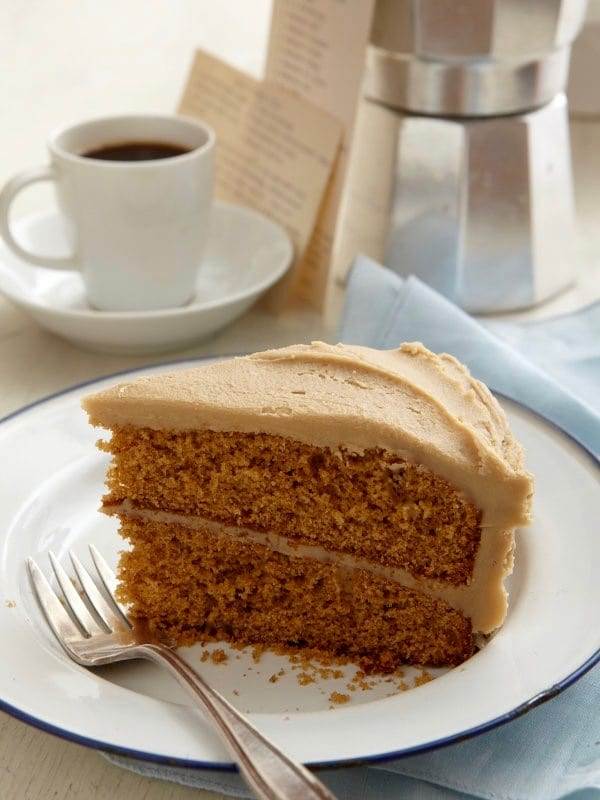 Spice Cake With Creamy Caramel Icing on white plate w fork