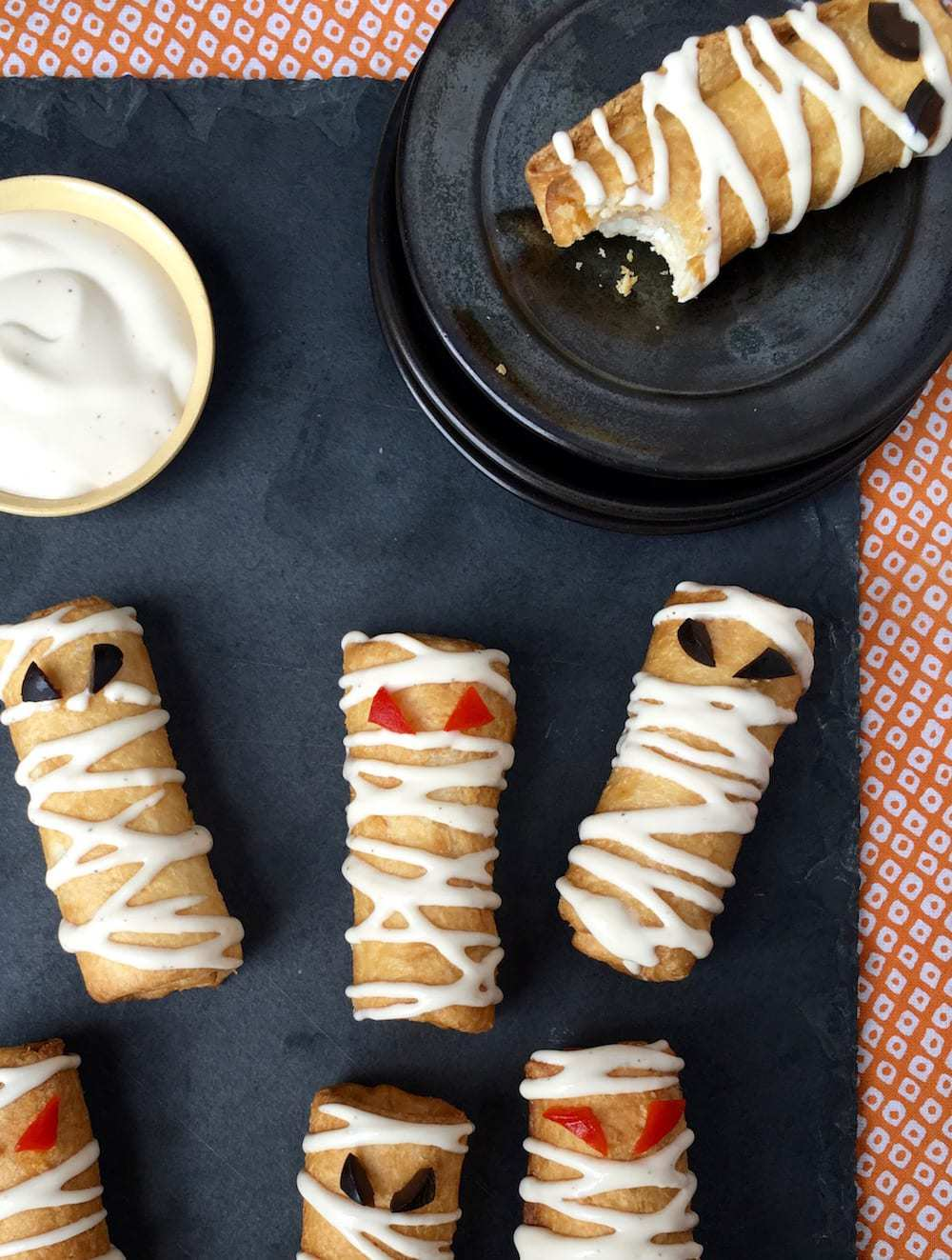 Pizza Roll Ups Mummy Snacks on slate and orange linen