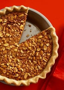 Gooey Peanut Pie is a take on classic pecan, with the addition of creamy peanut butter and salty nuts.