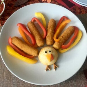 Mozzarella Sticks Turkey Snacks with red orange and yellow pepper slices