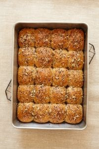 Dinner Rolls with Savory Seed Topping in baking pan