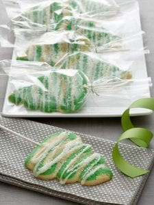 Christmas Tree Lollipop Cookies wrapped in clear plastic displayed on white platter