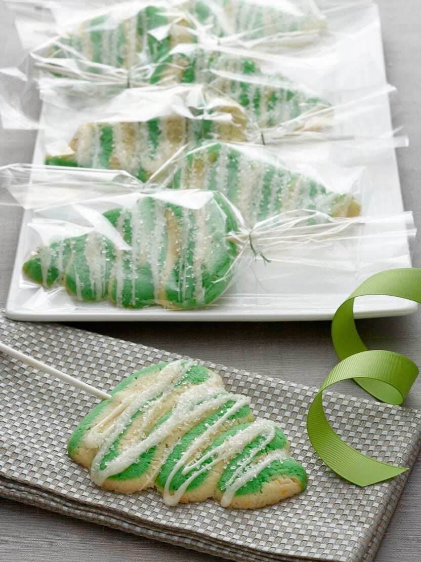 I colored half of the dough green after mixing it together. I wanted a tree cookie that was a little classy and a little fun, so I opted not to have a ...