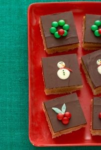 Decorated dulche de leche bars on red platter