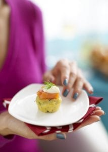 Caper Herb Corn Muffins with Smoked Salmon and creme fraiche on white plate