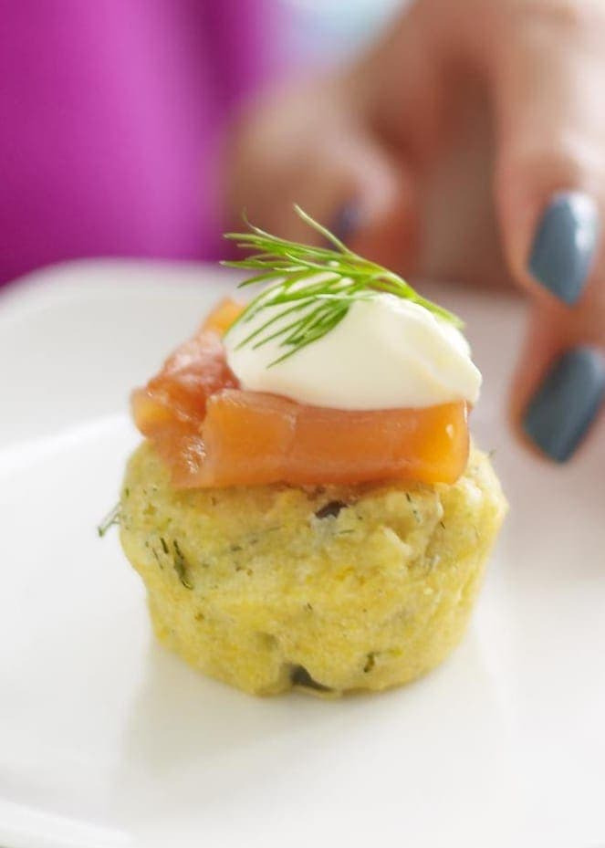 Caper Herb Corn Muffins with Smoked Salmon and creme fraiche on white plate close crop