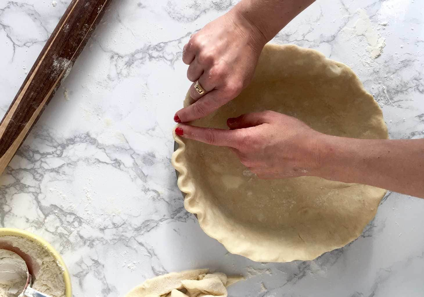 Rolling the perfect pie crust crimping.