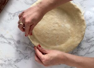 Example image of pinching the edges of the perfect pie crust