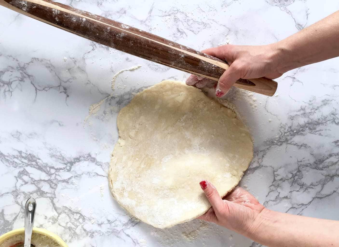 Rolling the perfect pie crust turning dough