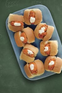 Overhead of Buffalo Chicken Bite Sliders on blue platter