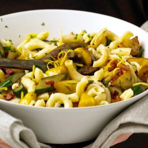 Close up of Squash and Pancetta pasta in white serving bowl