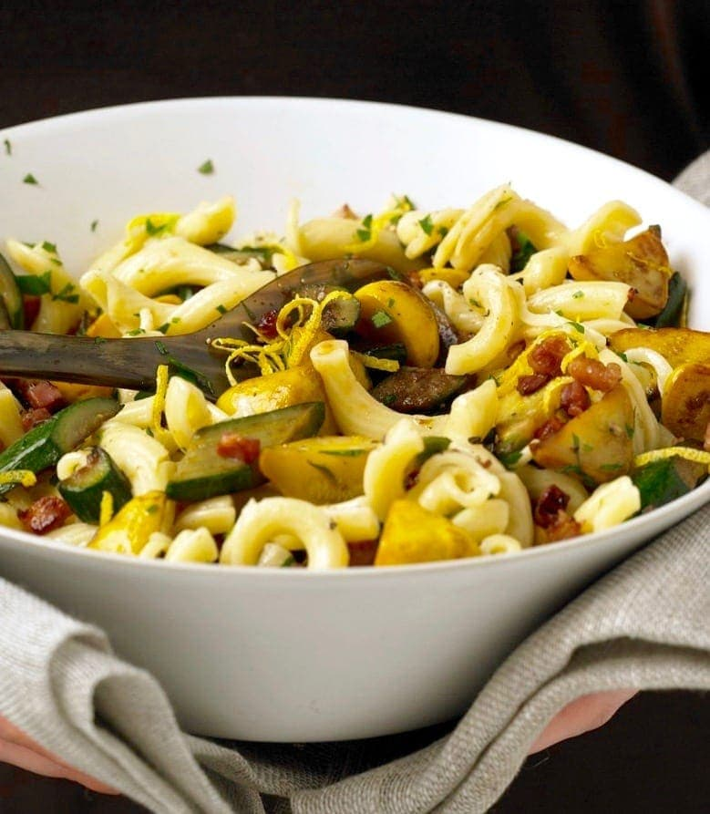 Squash and Pancetta pasta Close crop in white bowl