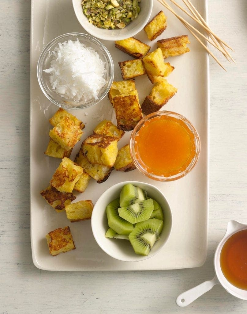 Oven baked French toast fondue makes a brunch much more fun and delicious.