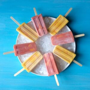 Halo Mandarin Pops on ice in white round platter on blue surface