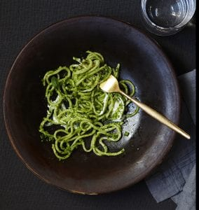 Winter pesto spaghetti with lemon ricotta in brown bowl