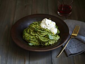 Pasta and pesto is made even better with a dollop of lemon cream.