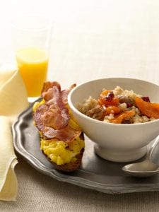 Cracked Wheat Cereal with Bacon and Egg Toasts on metallic plate