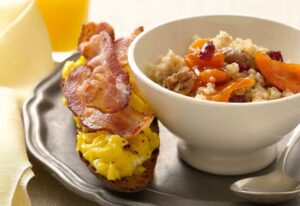 Close up of Cracked Wheat Cereal with Bacon and Egg Toasts