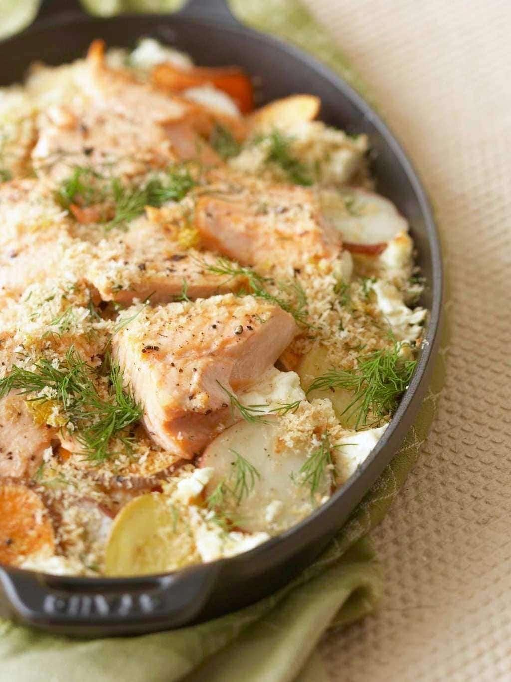 Easy Dinner Potato Salmon Bake overhead in black baking dish