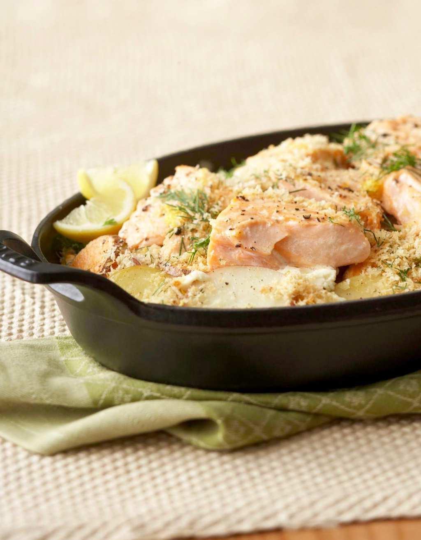 Easy Dinner Potato Salmon Bake in black baking dish