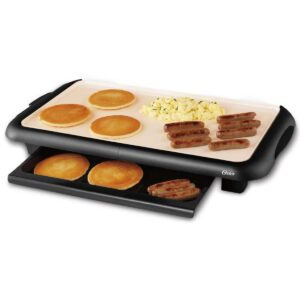 pancake griddle with pancakes, sausage and scrambled eggs