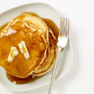 pancakes on white plate with syrup