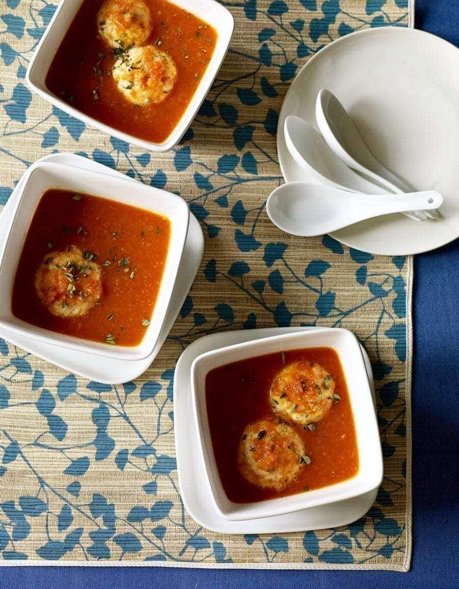 three bowls of tomato soup with dumplings