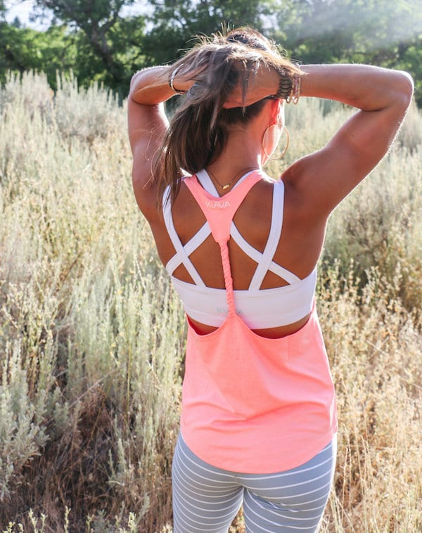 back of woman with pink tank