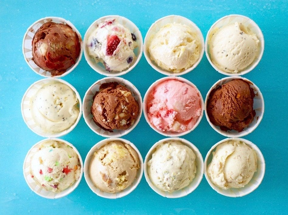 24 easy homemade ice cream flavors in cups on turquoise background