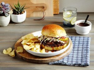 Slow Cooker Brisket Sandwich on table