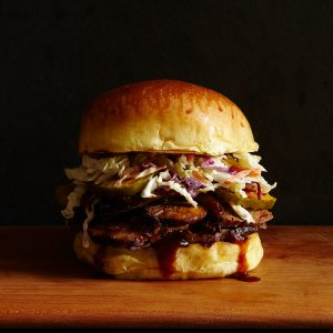 close up of Slow Cooker Brisket Sandwich on black background