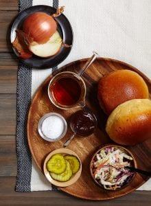 Slow Cooker Brisket Sandwich ingredients on wooden platter