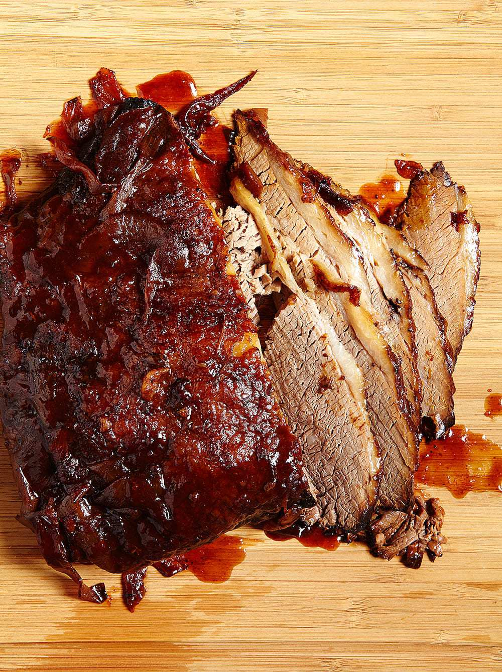 Slow Cooker Brisket Sandwich sliced on a cutting board