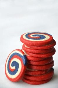 Colorful swirling cookies exhibit red, white and blue swirls