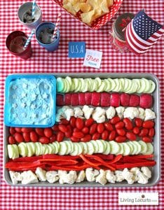 Colorful veggies arranged in an American flag pattern with blur dip bring a patriotic look to 4th of July food and Tara Teaspoon.