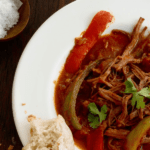 Ropa Vieja Cuban Beef Stew in a white bowl pin image