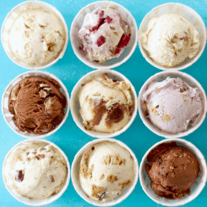 overhead shot of 9 flavors of homemade ice cream in cups
