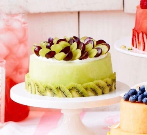 Make A Fresh Melon Cake With Melons Berries And Fruit That Turns Gathering Into
