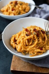 Creamy Butternut Squash Alfredo Pasta in white bowls on cutting board