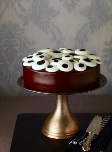 cake stand with chocolate cake and eyeball candy on top