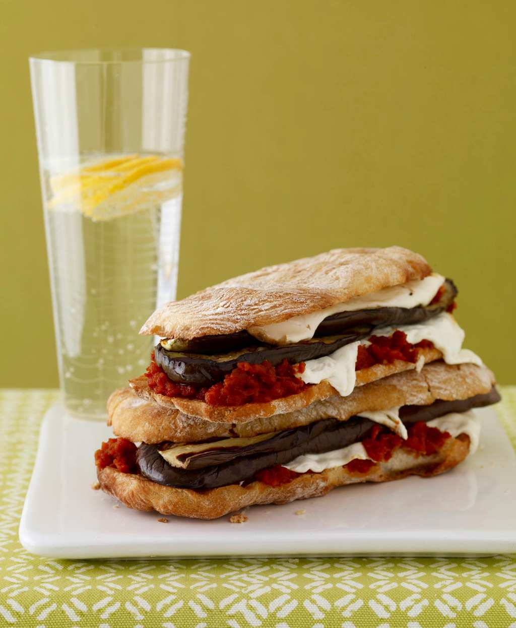 Mozzarella and eggplant panini on plate with water