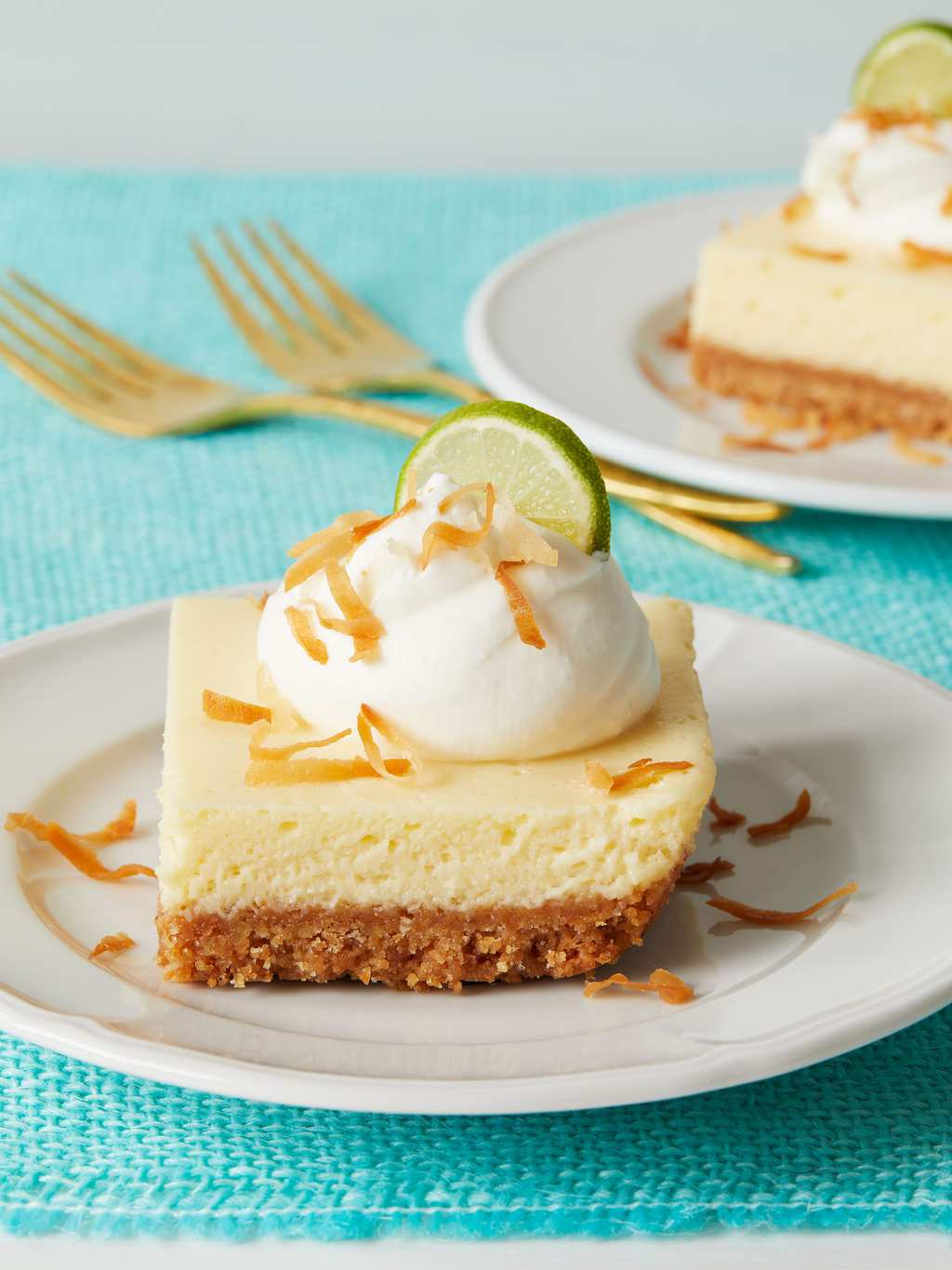 Coconut Key lime Bars on white plate and turquoise background