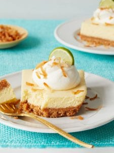 Key Lime Bars with bite out and gold fork