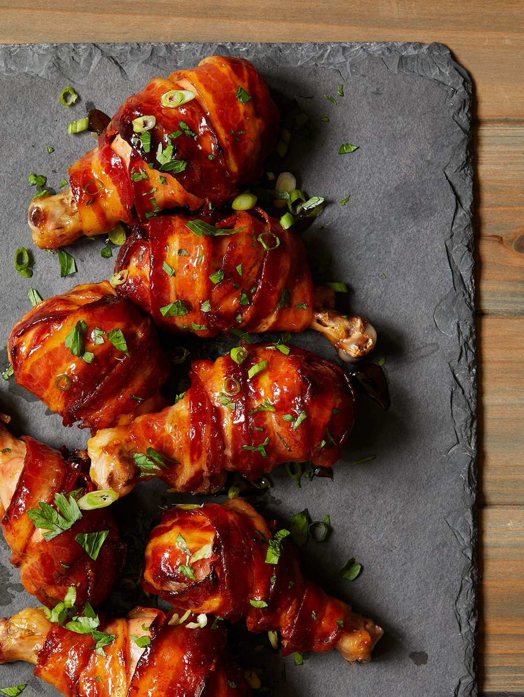 maple bacon chicken drumsticks on slate