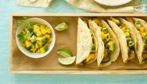 fish tacos with mango and avocado salsa close up