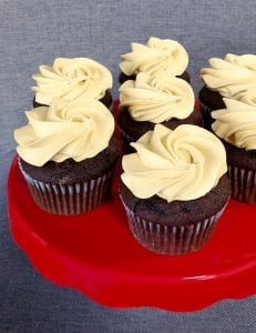 chocolate cupcakes with caramel icing on red plate